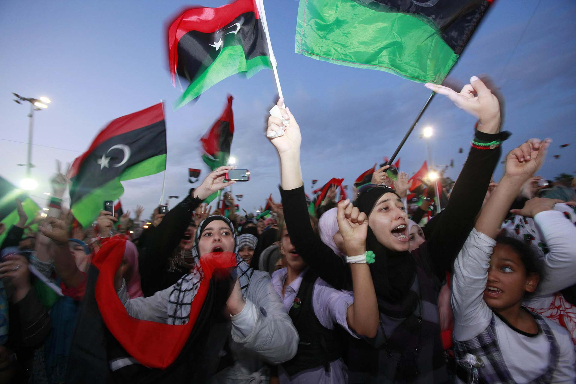 Women celebrate the overthrow of the Gaddafi regime in Misrata, Libya. Credit: Youssef Boudlal / Reuters